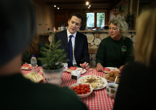 MARLDON, ENGLAND - OCTOBER 23: Chancellor of the Exchequer George Osborne looks at a micro Christmas tree as he takes tea with Sadie Lynes owner of Marldon Christmas Tree Farm on October 23, 2014 in Marldon, England. The Chancellor is on a two day tour meeting with women working in the UK economy. (Photo by Peter Macdiarmid/Getty Images)